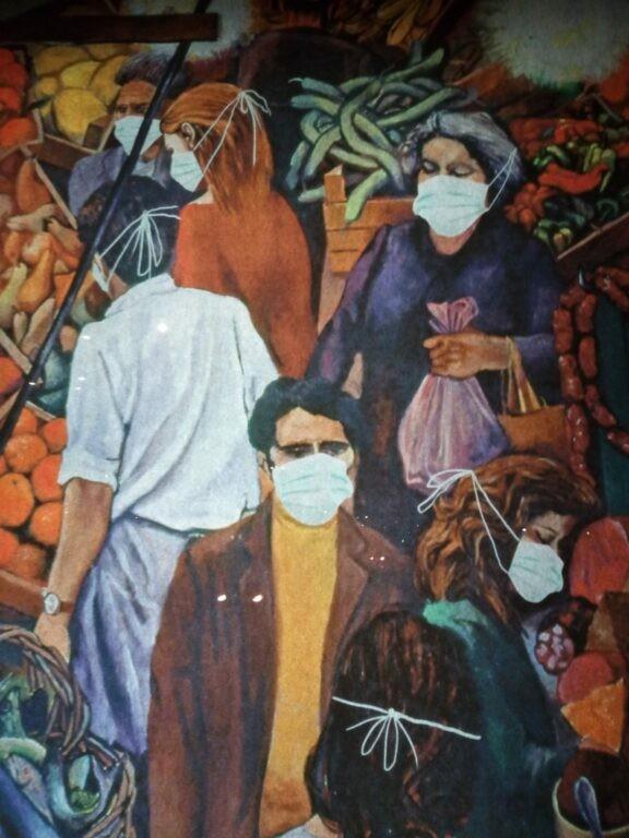 """Coronavirus, il Banksy torinese combatte la psicosi e """"maschera"""" il mercato di Guttuso - News Coronavirus"""